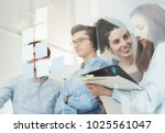 young business team meeting in... | Shutterstock . vector #1025561047
