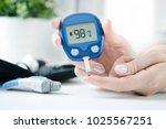 diabetes checking blood sugar... | Shutterstock . vector #1025567251