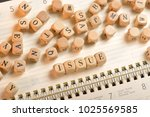 issue word on wooden cubes....   Shutterstock . vector #1025569585