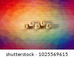issue word on wooden cubes....   Shutterstock . vector #1025569615