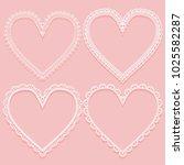 set of openwork white frames in ... | Shutterstock .eps vector #1025582287