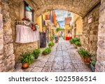 alleyway in old white town bari ... | Shutterstock . vector #1025586514
