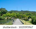 Small photo of Mount Lofty, South Australia, Australia - January 14, 2017: Visitors walking down the path alongside the pond at the Mount Lofty Botanic Gardens in the Adelaide Hills.