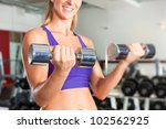 young woman is exercising with... | Shutterstock . vector #102562925
