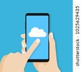 cloud icon on smartphone screen.... | Shutterstock .eps vector #1025629435