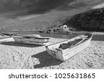 Small photo of Small fishing boat / ponga at Punta Lobos beach on the coast of Baja California Mexico BCS - black and white