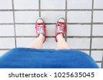 selfie of sneakers. woman... | Shutterstock . vector #1025635045