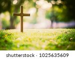 Small photo of The cross standing on meadow sunset and bokeh background.Cross on a hill as the morning sun comes up for the day.The cross symbol for Jesus christ.Christianity, religious, faith, Jesus or belief.