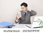 tired and stressed asian... | Shutterstock . vector #1025659939