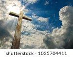 christian  cross on sky... | Shutterstock . vector #1025704411