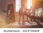 sporty girl doing weight... | Shutterstock . vector #1025734609