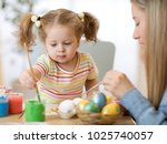 mother and child painting on... | Shutterstock . vector #1025740057