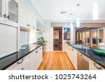 interior of kitchen in a new... | Shutterstock . vector #1025743264