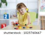 smart child girl plays in... | Shutterstock . vector #1025760667