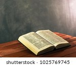 bible on a red wooden table.... | Shutterstock . vector #1025769745