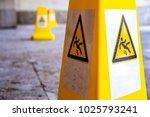 caution wet floor sign at a... | Shutterstock . vector #1025793241