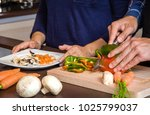 young couple cutting vegetables ...   Shutterstock . vector #1025799037