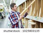 man chooses wooden baluster for ...   Shutterstock . vector #1025803135