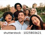 friends chilling outside taking ... | Shutterstock . vector #1025803621