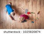 children play with wooden toy ... | Shutterstock . vector #1025820874