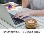 women typing on keyboard laptop.... | Shutterstock . vector #1025854087