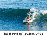 surfer in california surfs... | Shutterstock . vector #1025870431