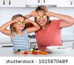 attractive woman cooking... | Shutterstock . vector #1025870689