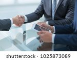 two confident businessmen... | Shutterstock . vector #1025873089