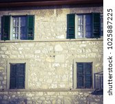 Small photo of Windows and balcony in the alpen villages