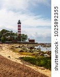 lighthouse on a sunny day.... | Shutterstock . vector #1025892355
