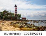 red and white lighthouse ... | Shutterstock . vector #1025892361