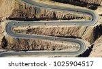 desert road   aerial image of... | Shutterstock . vector #1025904517