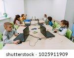 group of focused kids working... | Shutterstock . vector #1025911909