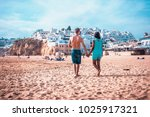 happy young couple walking at... | Shutterstock . vector #1025917321