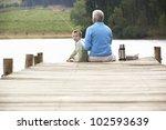 senior man fishing with grandson | Shutterstock . vector #102593639