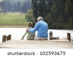 senior man fishing with grandson | Shutterstock . vector #102593675