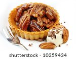 Pecan tart, with cream and shaved chocolate.  A delicious nutty dessert. - stock photo