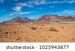 two mountains in the desert... | Shutterstock . vector #1025943877