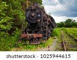 old rusty steam locomotive in... | Shutterstock . vector #1025944615