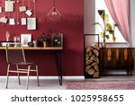 cupboard and logs of wood next... | Shutterstock . vector #1025958655