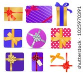 set of gift boxes with ribbons... | Shutterstock .eps vector #1025970391