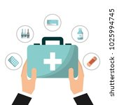 hand with first aid kit | Shutterstock .eps vector #1025994745