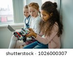 group of little schoolgirls... | Shutterstock . vector #1026000307