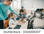 teacher helping his teen... | Shutterstock . vector #1026000337