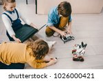 high angle view of kids sitting ... | Shutterstock . vector #1026000421