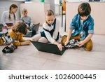 kids programming robots with... | Shutterstock . vector #1026000445