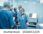 four multiethnic surgeons... | Shutterstock . vector #1026011224