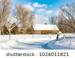 antique barn in rural quebec... | Shutterstock . vector #1026011821
