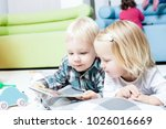 cute kids review the book | Shutterstock . vector #1026016669