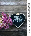 Small photo of hello spring chalkboard with tulips. Hello spring chalkboard in heart shape.